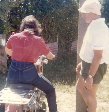 Dad teaching Catherine to ride motorbike